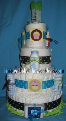front of diaper cake with cupcake graphics and bottle brush on top