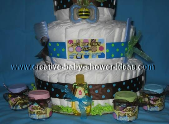 closeup of bottom of diaper cake with baby food bottle favors