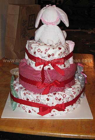 back of red and white bunny diaper cake with ribbon