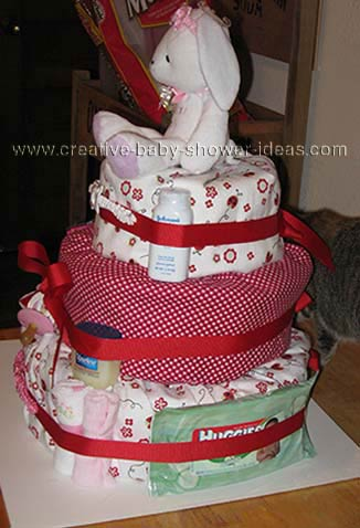 side of red and white bunny diaper cake