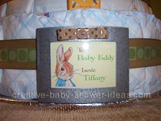 closeup of cute peter rabbit sign on diaper cake