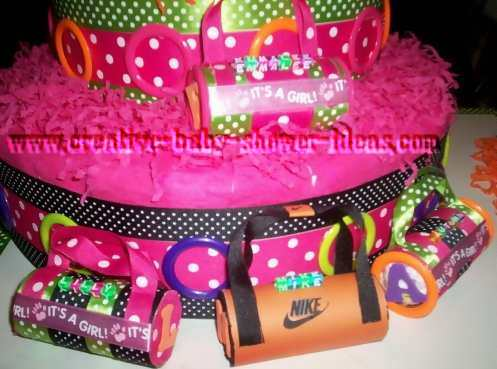closeup of mod dots diaper cake with diaper duffle bags