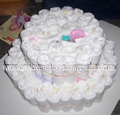 2 tiers of diaper cake being built