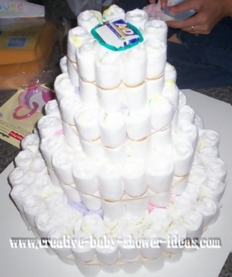 4 tier diaper cake being made