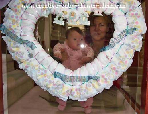heart shaped diaper wreath with baby and aunt