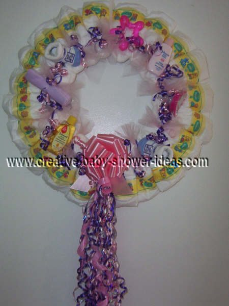 pink and purple baby diaper wreath