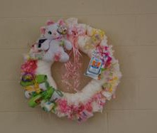 pink and white kitty cat diaper wreath