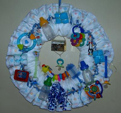 made this diaper wreath for my first grandson every bow was tied