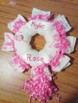 pink and white girl diaper wreath