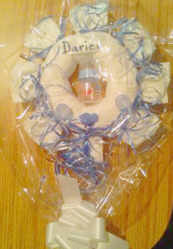 blue and white curling ribbon diaper wreath