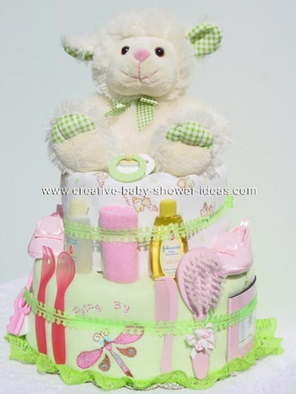 white and green lamb diaper cake