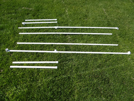 all of the cut pieces of pvc pipe for the backdrop