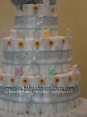 closeup of flowers and bears on doll diaper cake