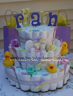 closeup of duck diaper cake on baby shower gift table