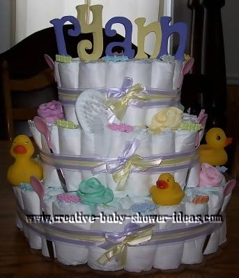 blue and yellow baby ryan diaper cake