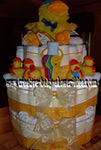 duck diaper cake with bright yellow ribbon and lots of rubber duckies