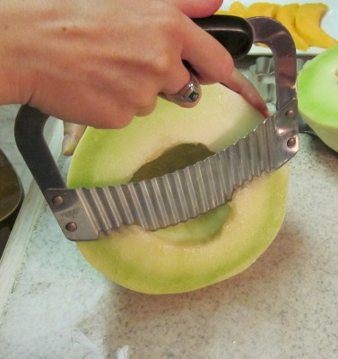 cutting honeydew spears for fruit bouquet