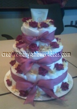 purple and cream flowers diaper cake