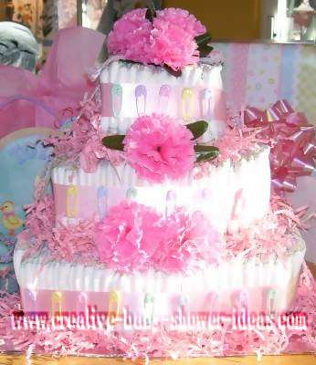 pink carnations and baby pins diaper cake