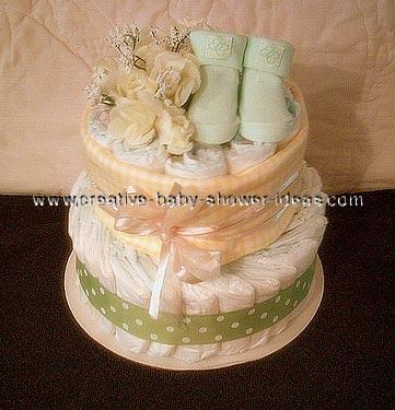 green baby bootie diaper cake