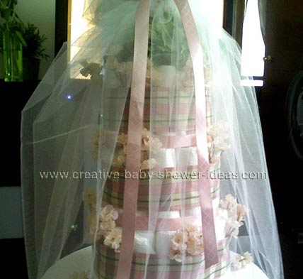 pink flowers and plaid ribbon diaper cake