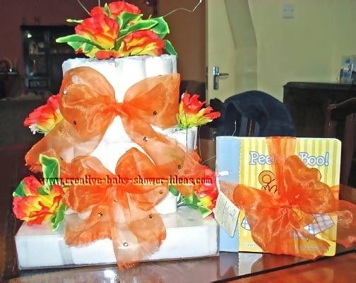 orange flowers and bows diaper cake