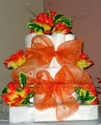 closeup of elegant orange roses diaper cake