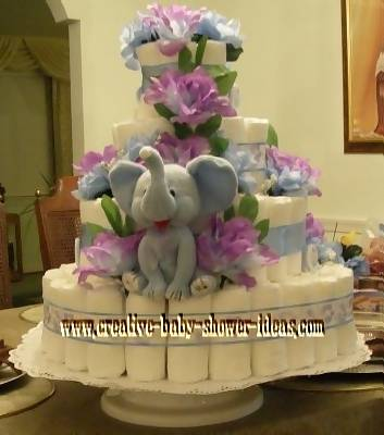 elegant blue and purple diaper cake with grey elephant and purple flowers