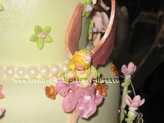 closeup of the fairies on the garden baby cake