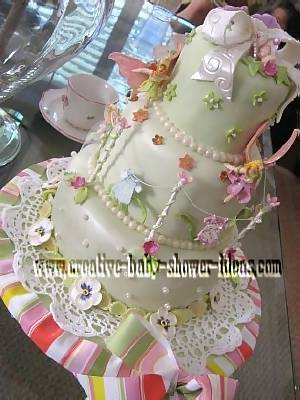 closeup of clothesline and bow on baby shower cake