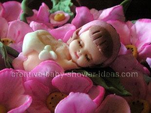 closeup of sleeping fondant baby in flowers