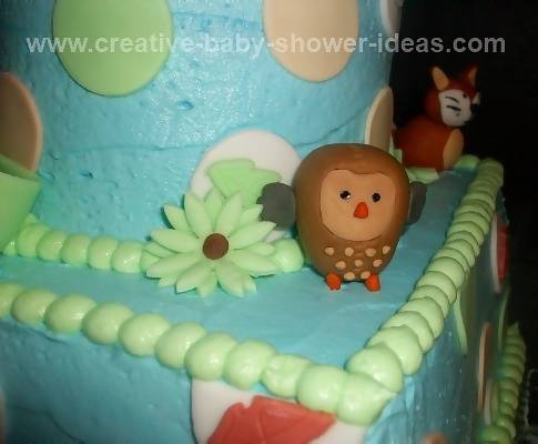 Closeup of forest friends baby cake showing owl and fox