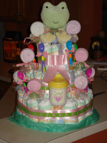 frog  and washcloth lollipops diaper cake