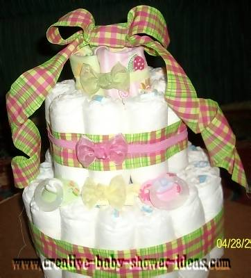 pink and green plaid frog diaper cake