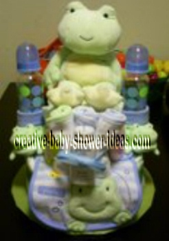 frog diaper cake with bottles and bibs