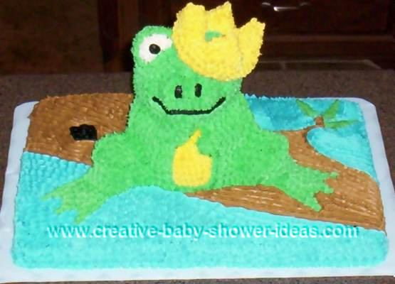 frog prince baby cake sitting on log with crown covering one eye