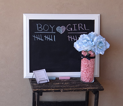 white and black chalkboard for gender reveal party