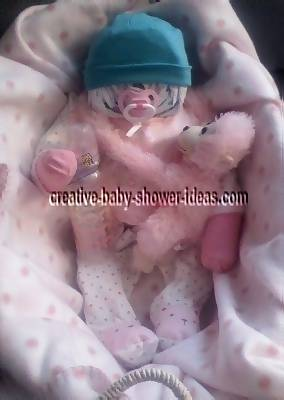 pink and white girl diaper baby with teal hat