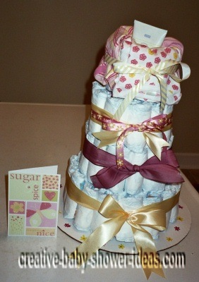 purple and gold sugar and spice diaper cake with invitation