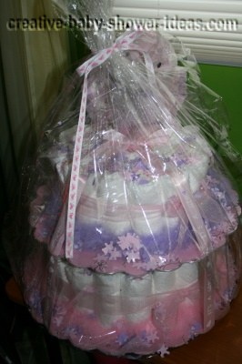 pink and purple teddy bear girl diaper cake wrapped in cellophane