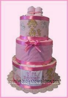 precious moments diaper cake with pink satin ribbon