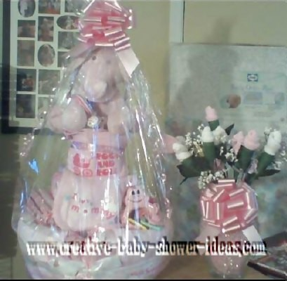 pink rock and roll girl diaper cake with sock rose bouquet