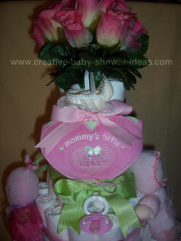 pink and green mommy's little sweetheart girl diaper cake