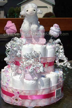 white lamb and washcloth roses girl diaper cake