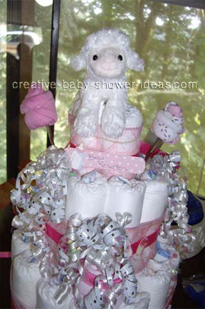 closeup of girl lamb diaper cake