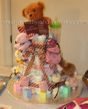 pink and brown polka dot bear diaper cake