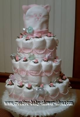 elegant pink and white pearls and roses diaper cake