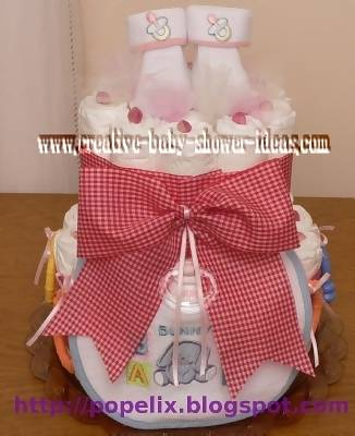 red and white plaid diaper cake with booties on top
