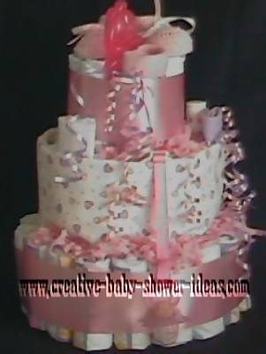 pink and white girl diaper cake with little hearts