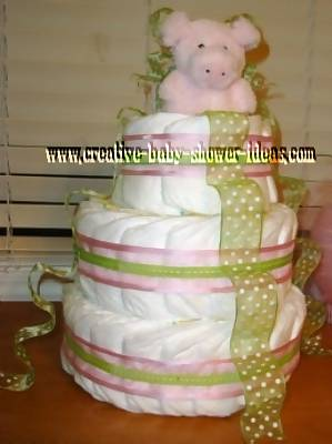 green and pink polka dot pig diaper cake